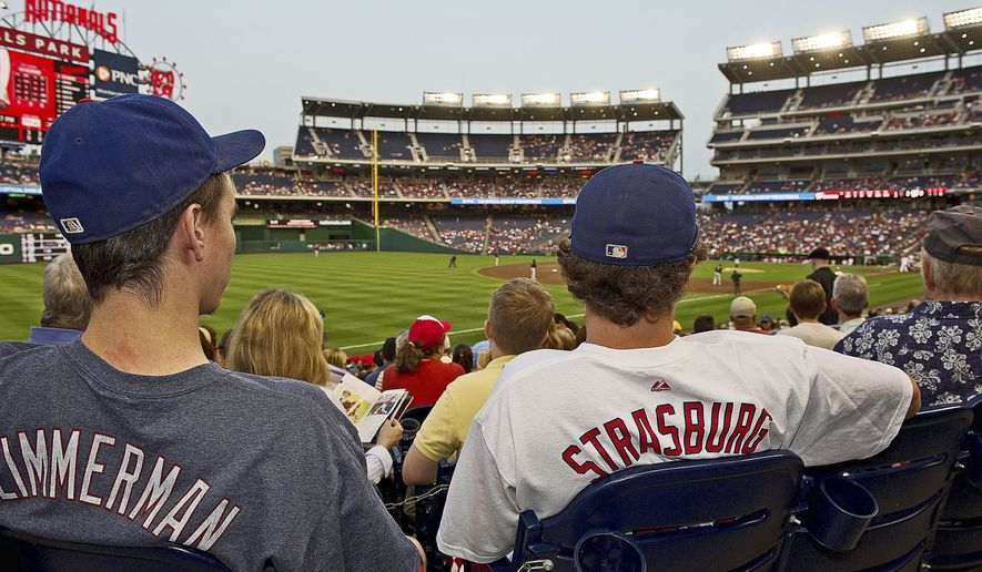 Photographs by Barbara L. Salisbury/The Washington Times Washington Nationals fans display their favorites Friday while watching the Nats take on the New York Mets at home.