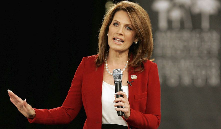 ASSOCIATED PRESS Rep. Michele Bachmann, a Republican presidential candidate, takes part in the American Principles Project Palmetto Freedom Forum in Columbia, S.C., on Monday. Mrs. Bachmann argued that the federal Constitution should prevent states from enacting individual mandates.