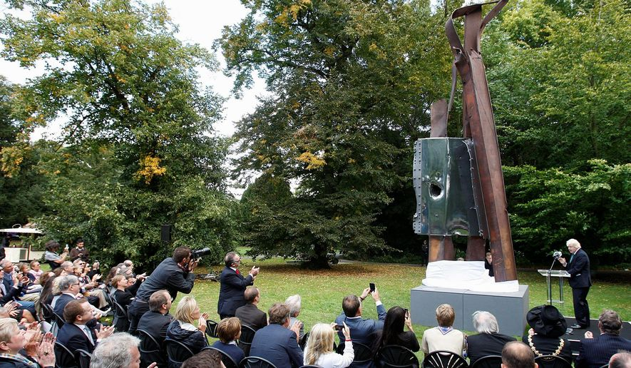 "London Mayor Boris Johnson unveils ""After 9/11"" in Battersea Park in London on Monday. ""It is only if we and our children properly remember and understand 9/11 that we can make sure that nothing like it ever happens again,"" he said. (Associated Press)"