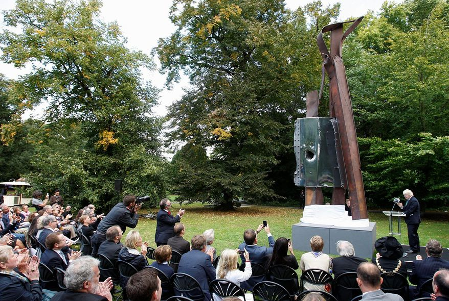 """London Mayor Boris Johnson unveils """"After 9/11"""" in Battersea Park in London on Monday. """"It is only if we and our children properly remember and understand 9/11 that we can make sure that nothing like it ever happens again,"""" he said. (Associated Press)"""