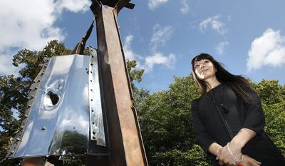 """New York artist Miya Ando shows her sculpture made from steel recovered from the remnants of the twin towers. """"After 9/11"""" was commissioned by the 911 London Project. (Associated Press)"""