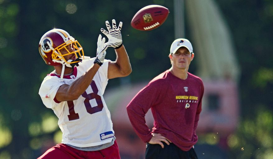 Washington Redskins wide receiver Terrence Austin (18) pulls down a pass during training camp at Redskins Park in Ashburn, Va, Wednesday, August 10, 2011. (Rod Lamkey Jr./The Washington Times)