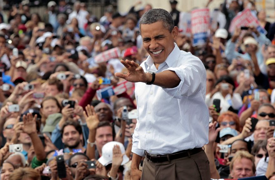 President Obama waves to supporters during a Labor Day speech at the Renaissance Center, headquarters of General Motors, in Detroit on Monday, Sept. 5, 2011. (AP Photo/Pablo Martinez Monsivais)