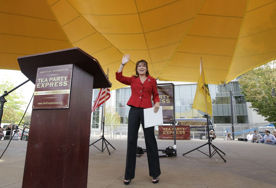 Former vice presidential candidate and Alaska Gov. Sarah Palin waves to supporters as she takes the stage before addressing a Tea Party Express Rally in Manchester, N.H., Monday afternoon, Sept. 5, 2011. Palin left open the possibility of a presidential bid Monday afternoon, while encouraging tea party activists to unite against President Obama. (AP Photo/Stephan Savoia)