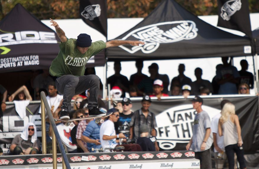 Top-seeded Andrew Reynolds of Hollywood, Calif., does a trick in midair during the final rounds of the skateboarding event. (Pratik Shah/The Washington Times)