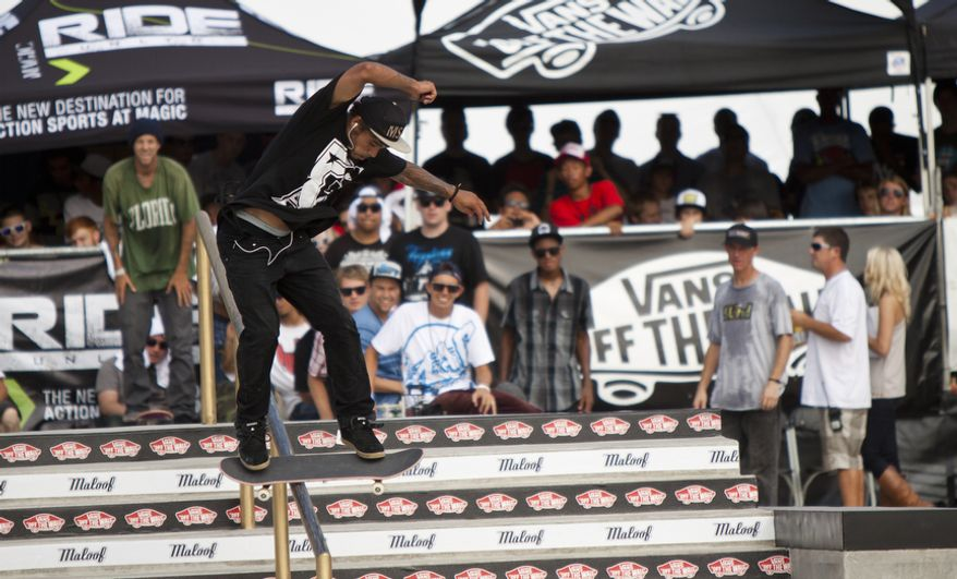 Manny Santiago of Lowell, Mass., skates down a railing during the final rounds of the competition. (Pratik Shah/The Washington Times)