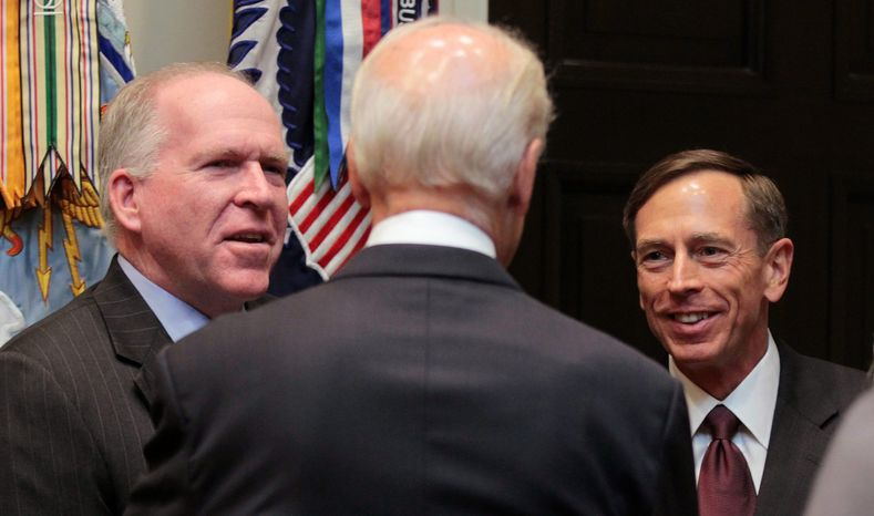 The new director of the CIA, David Petraeus (right), talks with Vice President Joseph R. Biden (back to camera) and John Brennan, President Obama's chief counterterrorism adviser, after Mr. Petraeus was sworn in at the White House on Tuesday. (Associated Press)