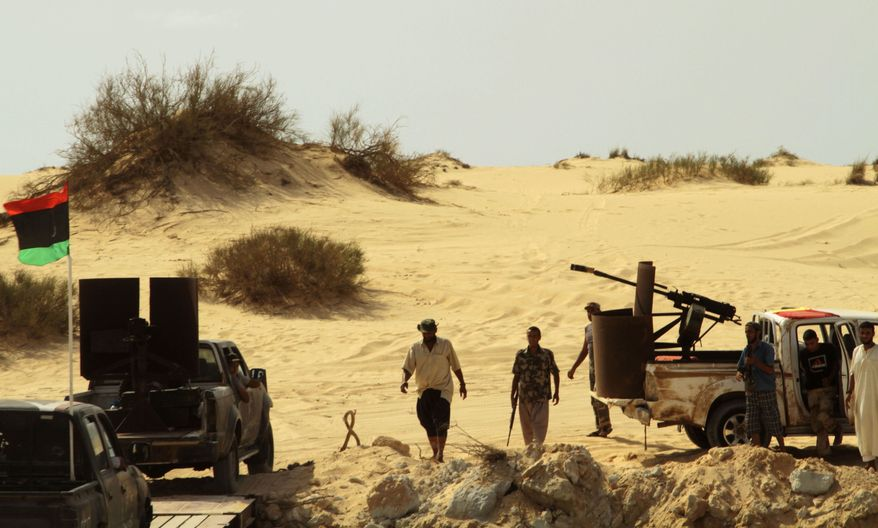 Libyan rebel fighters have positioned several outposts along the Mediterranean coast, some 37 miles south of Misrata, Libya, on Monday, Sept. 5, 2011. Troops are patrolling the coastal area to prevent incursions by Gadhafi supporters still in the towns that separate Misrata from Sirte. (AP Photo/Gaia Anderson)
