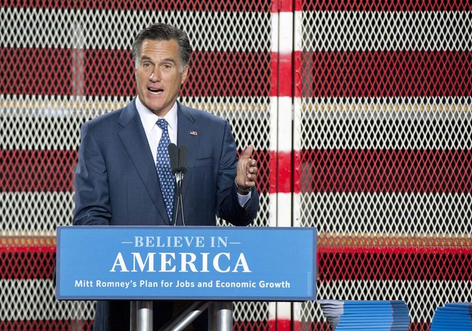 Republican presidential hopeful former Massachusetts Gov. Mitt Romney talks about his plan for creating jobs and improving the economy during a speech Tuesday, Sept. 6, 2011, in Las Vegas, at McCandless International Trucks. (AP Photo/Julie Jacobson)