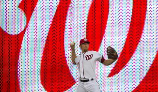 Washington Nationals pitcher Stephen Strasburg warms up near the warning track Sept. 6, 2011, as the Nationals host the Los Angeles Dodgers at Nationals Park in D.C. (Rod Lamkey Jr./The Washington Times)