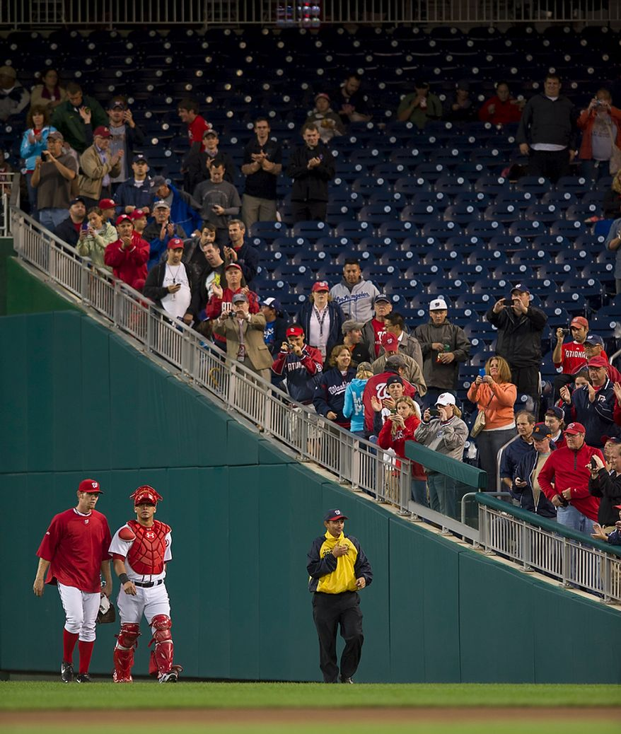 Washington Nationals pitcher Stephen Strasburg (left) and catcher Wilson Ramos (right) walk onto the field prior to the start of the game against the Los Angeles Dodgers at Nationals Park in Washington, DC, Tuesday, September 6, 2011. (Rod Lamkey Jr./The Washington Times)
