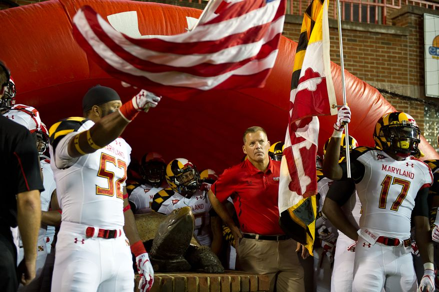 Head coach Randy Edsall, center, of the Maryland Terrapins waits with his team to take the field before the start of the game at Byrd Stadium at the University of Maryland, on Monday September 5, 2011. (Andrew Harnik / The Washington Times)