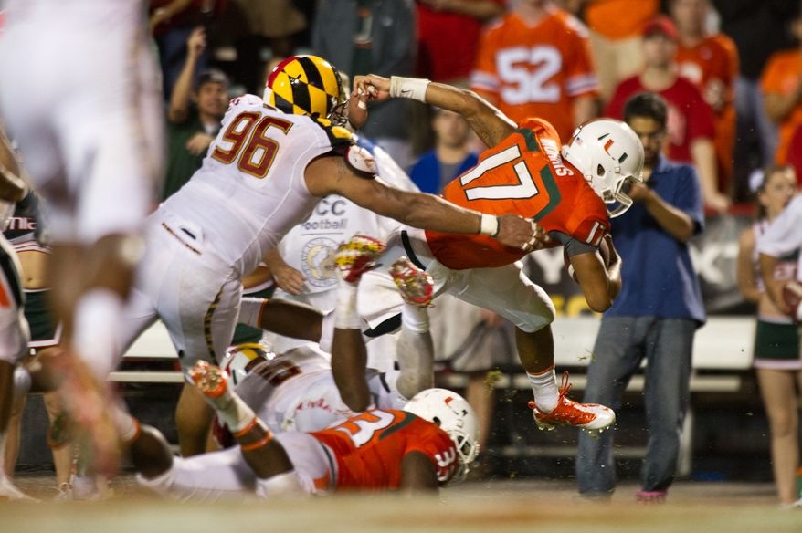 Quarterback Stephen Morris (17) of the Miami Hurricanes runs into the end zone for a touchdown in the second half at Byrd Stadium at the University of Maryland in College Park, MD, Monday September 5, 2011. (Andrew Harnik / The Washington Times)