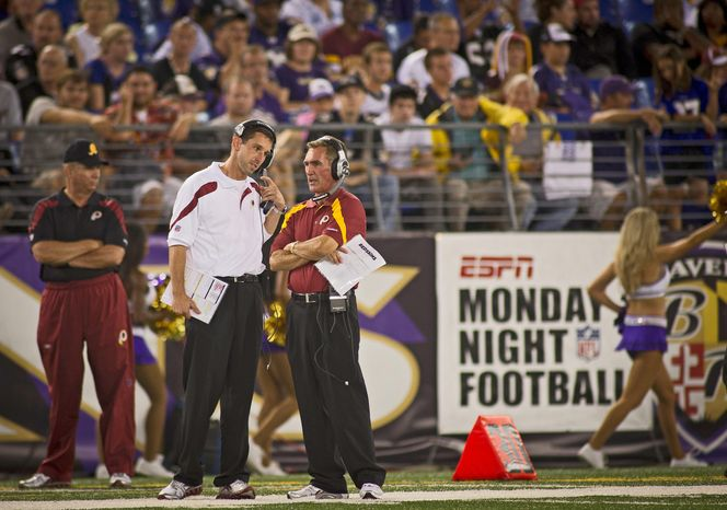 """Rod Lamkey Jr./The Washington Times Redskins coach Mike Shanahan took a chance by hiring his son, Kyle, as offensive coordinator last year. The veteran coach admitted he had never seen his new assistant run a meeting with the entire offense present. """"I was shocked to see how relaxed he was at his age,"""" the elder Shanahan said."""