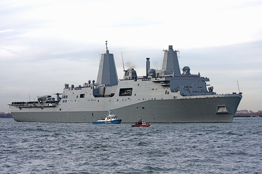 PHOTOGRAPH PROVIDED BY THE U.S. NAVY The USS New York, with more than 7 tons of steel from the World Trade Center built into its bow, is carrying families of 9/11 victims and first responders from Norfolk, Va., to New York for the 10th anniversary of the attacks.