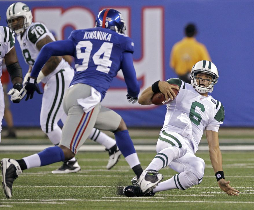 New York Jets quarterback Mark Sanchez, right, slides to avoid a tackle by New York Giants' Mathias Kiwanuka (94) during the first quarter of an NFL preseason football game Monday, Aug. 29, 2011, in East Rutherford, N.J. (AP Photo/Julio Cortez)