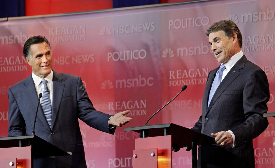 PARTY POLITICS: Former Massachusetts Gov. Mitt Romney (left) and Texas Gov. Rick Perry spar during a Wednesday debate held at the Reagan Library in Simi Valley, Calif., among eight Republicans seeking the 2012 GOP presidential nod. (Associated Press)