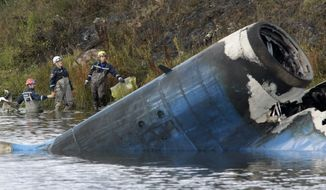The wreckage of a Russian Yak-42 jet is seen near the city of Yaroslavl, on the Volga River about 150 miles northeast of Moscow, on Sept. 7, 2011. The jet, carrying the Lokomotiv ice hockey team from Yaroslavl, crashed while taking off, officials said. (Associated Press)