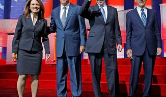 Republican presidential candidates Michele Bachmann, left, Mitt Romney, second from left, Rick Perry, second from right, and Ron Paul stand together before a Republican presidential candidate debate at the Reagan Library Wednesday, Sept. 7, 2011, in Simi Valley, Calif.  (AP Photo/Chris Carlson)