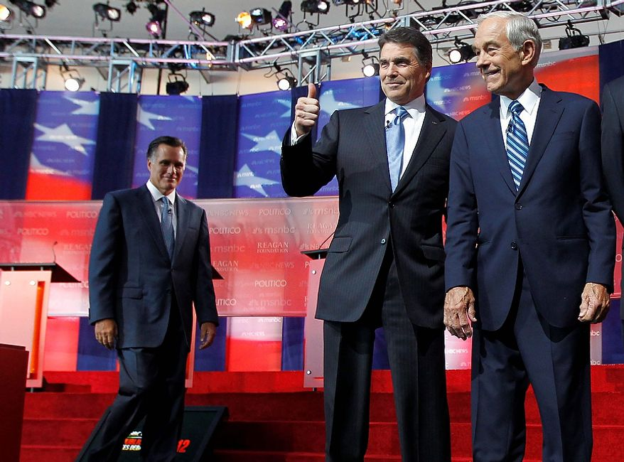 Republican presidential candidates Mitt Romney, left, Texas Gov. Rick Perry, center, and Rep. Ron Paul, R-Texas, take the stage before a Republican presidential candidate debate at the Reagan Library Wednesday, Sept. 7, 2011, in Simi Valley, Calif.  (AP Photo/Chris Carlson)