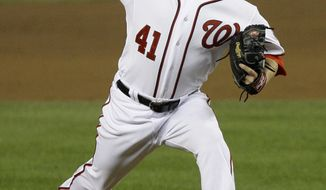 Washington Nationals relief pitcher Brad Peacock (41) makes his major league debut pitching against the Los Angeles Dodgers during the sixth inning of a baseball game at Nationals Park in Washington, on Tuesday, Sept. 6, 2011. (AP Photo/Jacquelyn Martin)