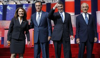 ** FILE ** Republican presidential candidates Michele Bachmann, left, Mitt Romney, second from left, Rick Perry, second from right, and Ron Paul stand together before a Republican presidential candidate debate at the Reagan Library Wednesday, Sept. 7, 2011, in Simi Valley, Calif. (AP Photo/Chris Carlson)