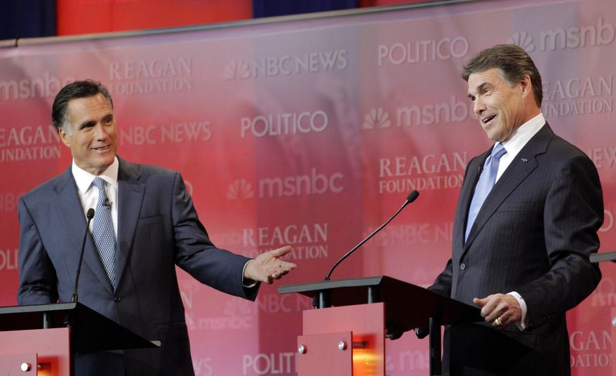 Republican presidential candidates former Massachusetts Gov. Mitt Romney, left, and Texas Gov. Rick Perry answer a question during a Republican presidential candidate debate at the Reagan Library Wednesday, Sept. 7, 2011, in Simi Valley, Calif. (AP Photo/Jae C. Hong)