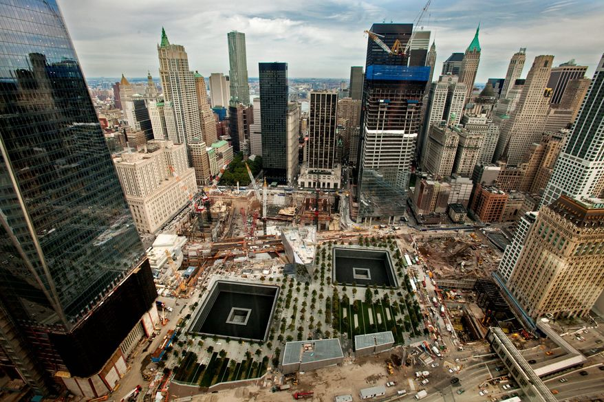 From the nearby World Financial Center, one can see ground zero and the cavities left in Lower Manhattan by the towers destroyed Sept. 11, 2001. Construction workers are making progress on 1 World Trade Center, the largest of four towers planned as part of the $18.7 billion ground zero project. (Andrew Harnick/The Washington Times)