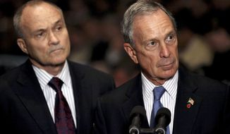 ** FILE ** New York Mayor Michael Bloomberg (right) and New York Police Commissioner Raymond Kelly take a question after ceremonies swearing in new police recruits in New York in July 2010. (AP Photo/Craig Ruttle, File)