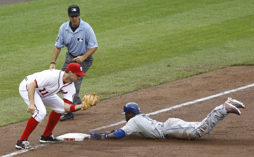 Los Angeles Dodgers' Tony Gwynn, right, steals third base as Washington Nationals third baseman Ryan Zimmerman (11) attempts the tag during the ninth inning of the first baseball game of a doubleheader, Thursday, Sept. 8, 2011, in Washington. The Dodgers won 7-4. (AP Photo/Luis M. Alvarez)