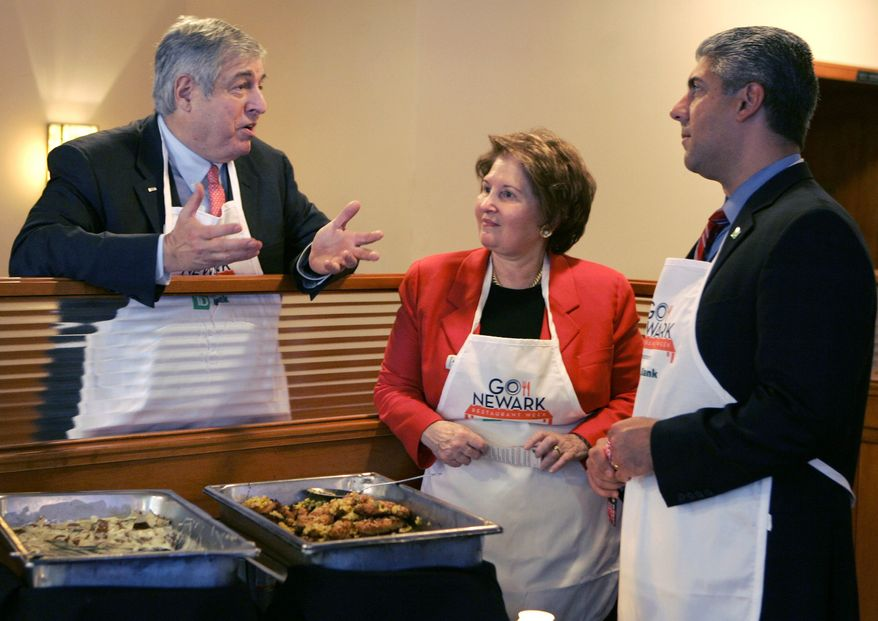 ** FILE ** Tim Zagat (left) and his wife, Nina Zagat, the founders of the restaurant review service Zagat, talk with Nicholas Mecili, an executive with TD Bank, at 60 Park Place Grill in Newark, N.J., in November 2008. Google announced on Thursday, Sept. 7, 2011, it had purchased the Zagats' firm, but they will remain as co-chairs. (AP Photo/Mike Derer, File)