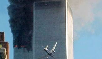 ** FILE ** United Airlines Flight 175 approaches the south tower of the World Trade Center in New York on Sept. 11, 2001, shortly before collision as smoke billows from the north tower. (AP Photo/Carmen Taylor)