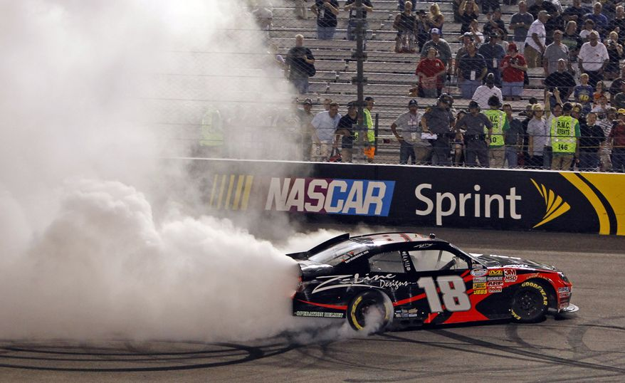 Kyle Busch does a burnout as he celebrates winning the NASCAR Nationwide auto race at Richmond International Raceway in Richmond, Va., Friday, Sept. 9, 2011. (AP Photo/Steve Helber)