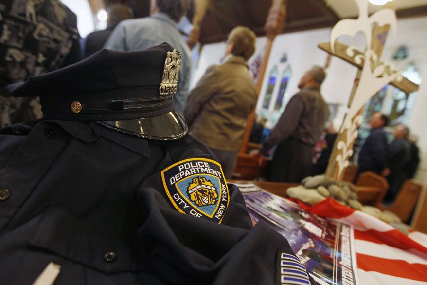 A uniform from the NYPD is displayed during a special service to commemorate the 10th anniversary of the Sept. 11 terrorist attacks, at a church in New Plymouth, New Zealand, Sunday, Sept. 11, 2011. The U.S. team will play Ireland in their opening Rugby World Cup game later today. (AP Photo/Dita Alangkara)