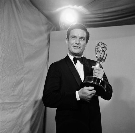 ** FILE ** In this May 22, 1966, file photo, actor Cliff Robertson holds the Emmy he won for the outstanding single performance by an actor in a leading role in a drama at the 18th annual Television Academy Awards in the Hollywood section of Los Angeles. Robertson died Saturday, Sept. 10, 2011. He was 88. (AP Photo)