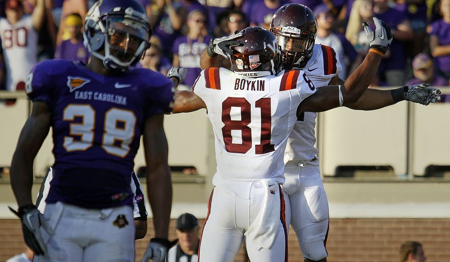 Virginia Tech's Josh Oglesby, right rear, celebrates his go -head touchdown with teammate Jarrettt Boykin (81) as East Carolina's Trent Tignor (38) walks away during the second half of an NCAA college football game in Greenville, N.C., Saturday, Sept. 10, 2011. Virginia Tech won 17-10. (AP Photo/Karl DeBlaker)