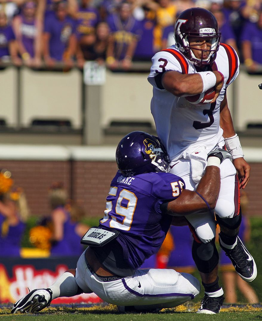 Virginia Tech quarterback Logan Thomas tries to break away from East Carolina's Daniel Drake (59) during the first half of an NCAA college football game in Greenville, N.C., Saturday, Sept. 10, 2011. (AP Photo/Karl DeBlaker)