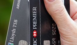 ASSOCIATED PRESS Two bank smartcards displayed in London have built-in chips. The cards are recognizable by the fingernail-sized gold contacts embedded on one side.