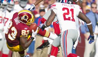 Andrew Harnik / The Washington Times Fred Davis (83) catches a 23-yard pass Sunday in the win against the Giants.
