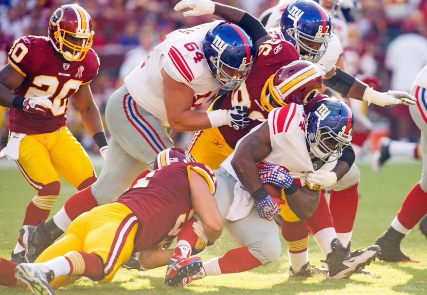 Redskins defenders stop Giants running back Ahmad Bradshaw for no gain at the end of the second quarter at FedEx Field. Bradshaw finished with 44 yards on 13 carries. (Rod Lamkey Jr./The Washington Times)