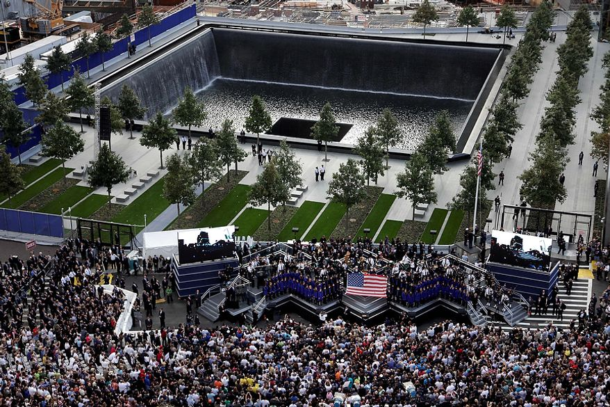 The World Trade Center ceremony marking the 10th anniversary of the attacks,  takes place at the National September 11 Memorial, Sunday, Sept. 11, 2011 in New York. (AP Photo/Mark Lennihan)