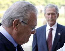 Former Defense Secretary Donald H. Rumsfeld (left) and former President George W. Bush pause for a moment of silence after laying a wreath at the Pentagon on Saturday, Sept. 10, 2011, in commemoration of the 10th anniversary of the Sept. 11 attacks. (AP Photo/Charles Dharapak)