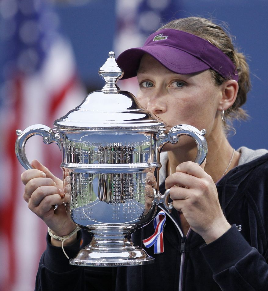 Samantha Stosur, of Australia, poses with the championship trophy after beating Serena Williams at the U.S. Open in New York on Sunday, Sept. 11, 2011. (AP Photo/Charles Krupa)