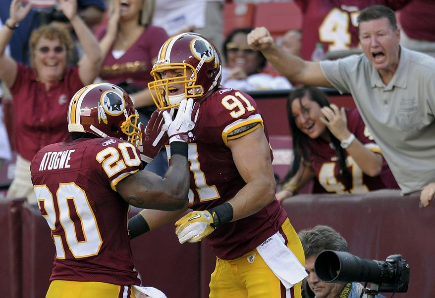 Washington Redskins linebacker Ryan Kerrigan celebrates his touchdown with teammate defensive back Oshiomogho Atogwe (20) during the second half of an NFL football game against the New York Giants, Sunday, Sept. 11, 2011, in Landover, Md. (AP Photo/Susan Walsh)