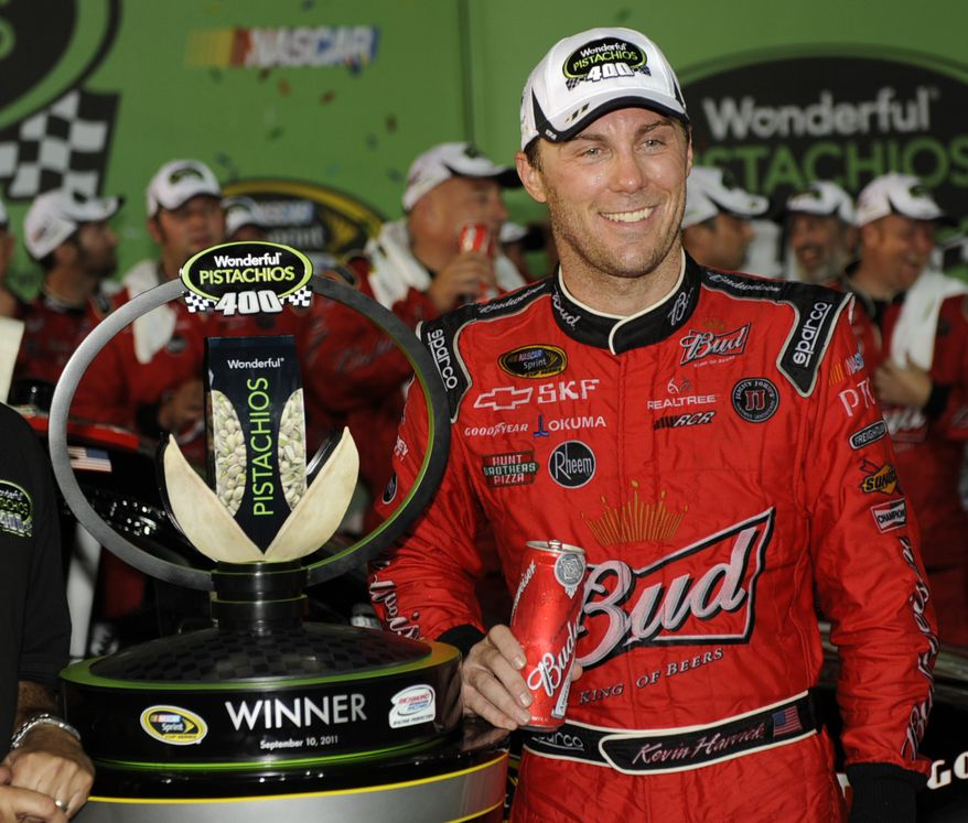 Kevin Harvick stands with the trophy after winning the NASCAR Sprint Cup Series auto race at Richmond International Raceway in Richmond, Va. on Saturday Sept. 10, 2011. (AP Photo/Clem Britt)