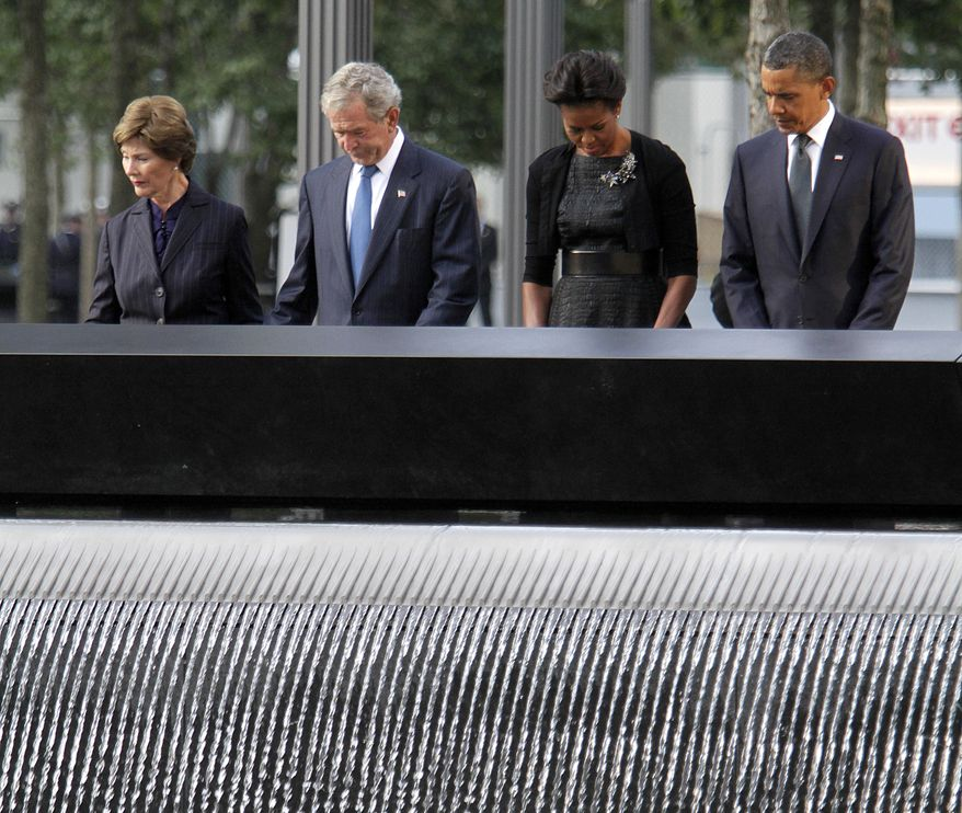Observing a moment of silence at the National September 11 Memorial in New York on Sunday, Sept. 11, 2011, are (from right) President Obama, first lady Michelle Obama, former President George W. Bush and former first lady Laura Bush. (AP Photo/Mary Altaffer)