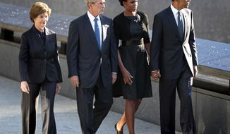 President Obama (from right), first lady Michelle Obama, former President George W. Bush and former first lady Laura Bush visit the North Memorial Pond at the National Sept. 11th Memorial on Sunday, Sept., 11, 2011, in New York. (AP Photo/Pablo Martinez Monsivais)