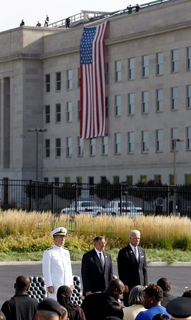 Adm. Mike Mullen (left), Defense Secretary Leon E. Panetta (center) and Vice President Joseph R. Biden Jr. stand during the playing of the national anthem at the Pentagon in Arlington on Sunday, Sept. 11, 2011, the 10th anniversary of the Sept. 11 attacks. (AP Photo/Charles Dharapak)