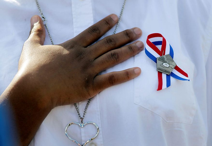 The 10th anniversary of the Sept. 11 attacks is observed at the Pentagon in Washington on Sunday, Sept. 11, 2011. (AP Photo/J. Scott Applewhite)