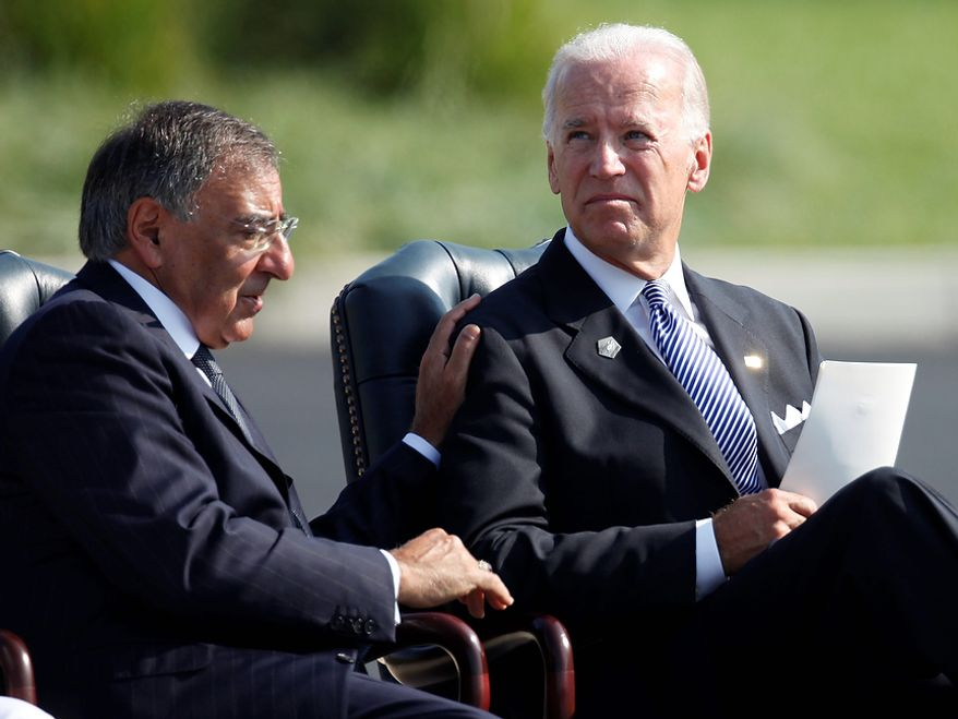 Vice President Joseph R. Biden Jr. (right) and Defense Secretary Leon E. Panetta participate in a commemorative ceremony on the 10th anniversary of the Sept. 11 attacks at the Pentagon in Washington on Sunday, Sept. 11, 2011. (AP Photo/Charles Dharapak)